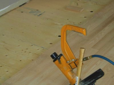 What type of tool should be used to install tongue and groove flooring?